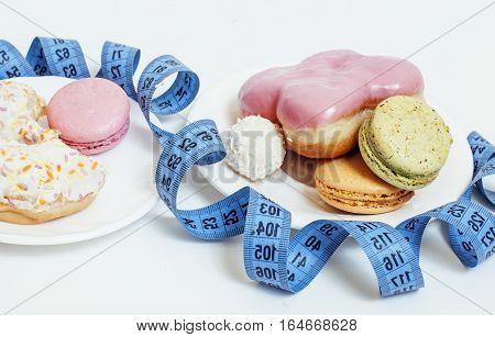 new real diet concept, question sign in shape of measurment tape between red apple and donut isolated on white close up