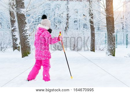 Girl Is Skiing In Snow Park