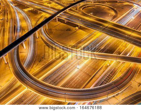 Extraordinary Thoroughfare Leading To Abu Dhabi During Night Rush Hour Near Biggest Skyscrapers. Tra
