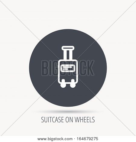 Suitcase with wheels icon. Travel baggage sign. Round web button with flat icon. Vector