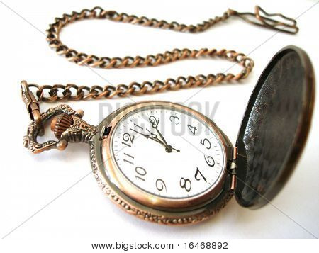 close-up of old golden clock on white background