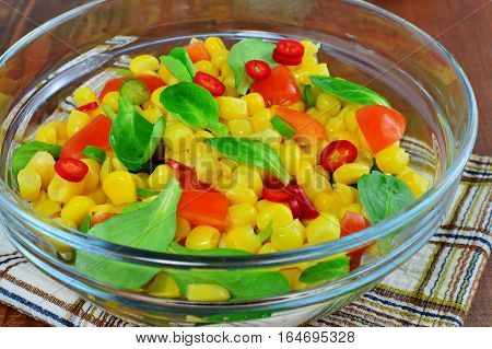 Fresh vegetable salad with corn lamb's lettuce chilly sweet pepper and tomatoes