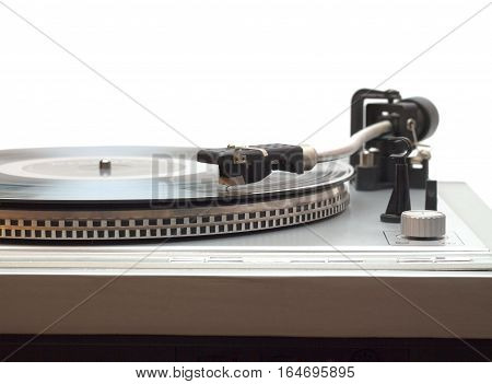 Turntable with vinyl record isolated on white front view closeup