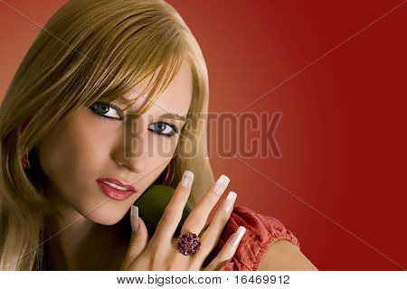 attractive girl with lime on red background