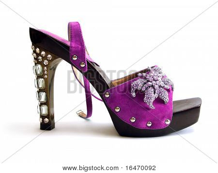 beautiful purple woman shoes with brilliant isolated on white background