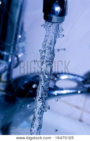water  running down from faucet in blue color