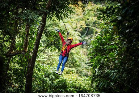 Woman going on a jungle zip line adventure asia