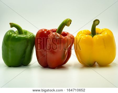 Many paprika on white background sweet pepper bell pepper
