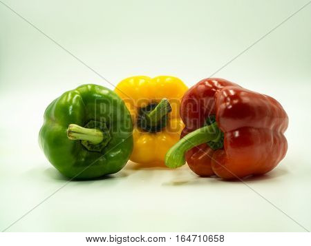 Green Yellow and Red paprika on white background sweet pepper bell pepper