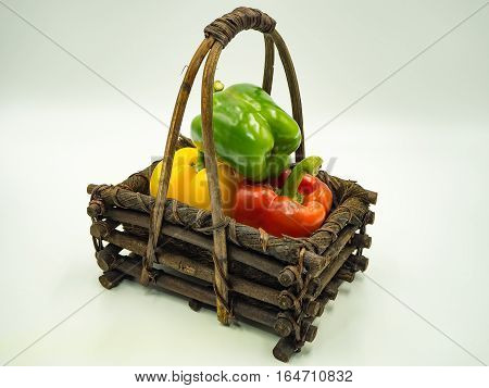 Paprika in the basket on white background sweet pepper bell pepper