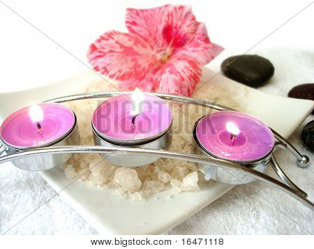 Spa essential (candles, salt, towel, flower and stones)