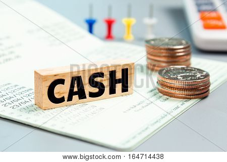 Text message Cash on wooden with book bank, stacked coins. Finance concept