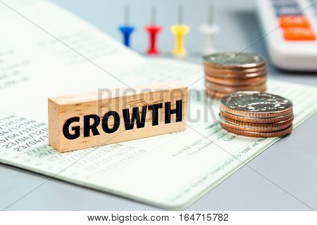 Text message Growth on wooden with book bank, stacked coins. Finance concept