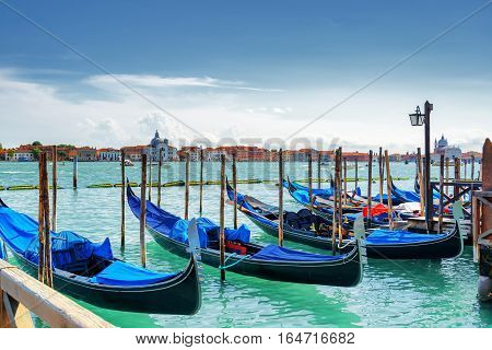 Gondolas Parked Beside The Riva Degli Schiavoni, Venice, Italy