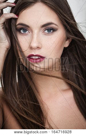 strong facial expression and emotion concept - young woman portrait with internal happiness on her face