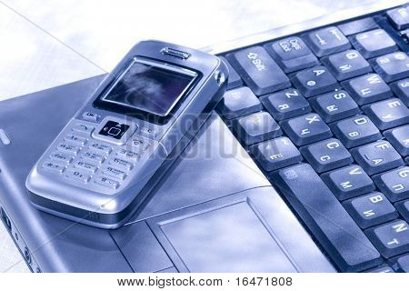 Mobile phone and computer keyboard (business conception)