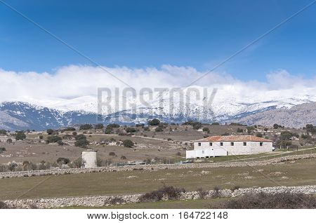 Farm house at Guadarrama Mountains. It is a mountain range forming the main eastern section of the Sistema Central, the system of mountain ranges at the centre of the Iberian Peninsula