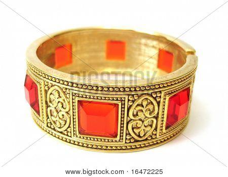 Close-up of golden bracelet isolated on white background