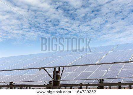 solar panels against a blue sky renewable energy background
