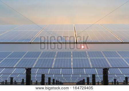 solar panels against a dusk sky renewable energy background