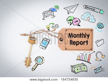 Monthly Report. Key and a note on a white background.
