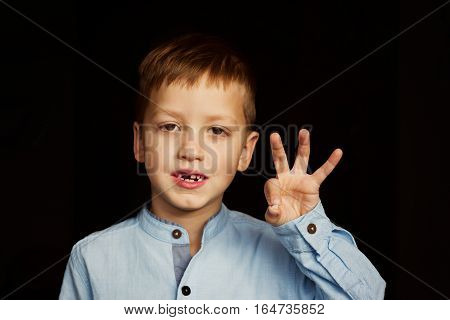 Little Smiling Child, Boy Hand Showing His First Milk Or Temporary Teeth Fall Out.