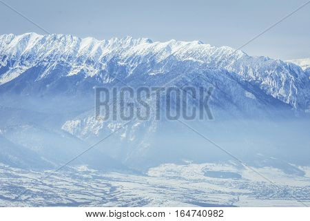 Winter Landscape Over The Piatra Craiului Mountains In Brasov County, Romania.view Of The Carpathian