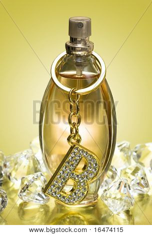 golden bottle of perfume with diamonds and letter B