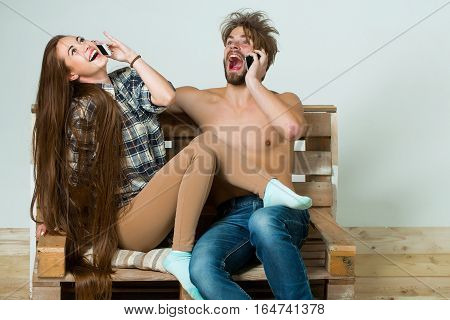 Young Couple Talk On Phone