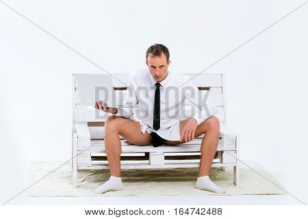 Serious Businessman With Laptop