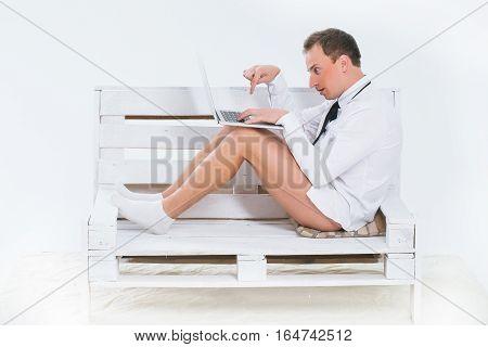 Curious Businessman With Laptop