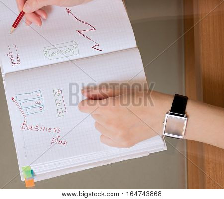 Business plan. Smart watch on a female hand. Planning concept
