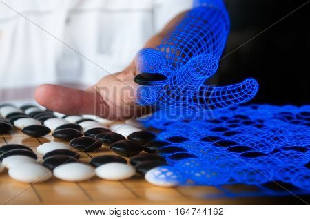 Human plaing Go blended to blue computer wireframe representing artificial intelligence concept.
