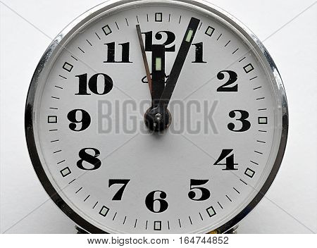 Detailed view of an old alarm clock and a white background
