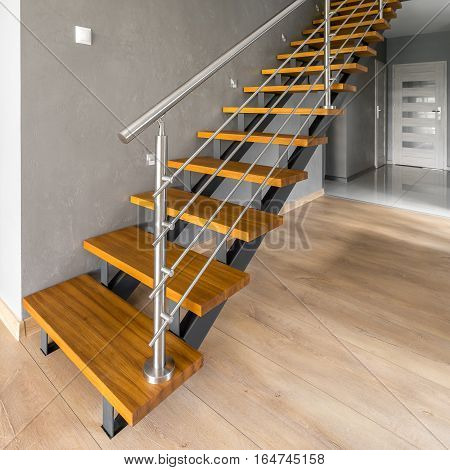 Wooden Stairs With Silver Railing