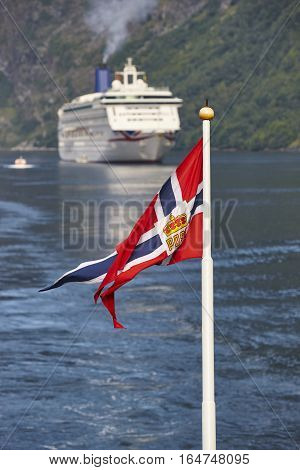 Norwegian flag. Norway fjord landscape with cruise. Travel background. Tourist