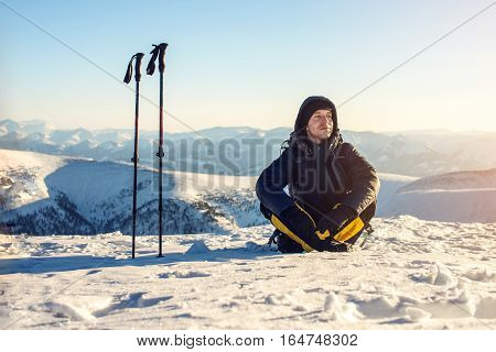 Man Hikers Tourists Sitting Meditating After A Hard Ascent Alone