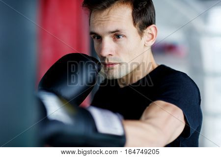 Portrait of young sportsman training in gym