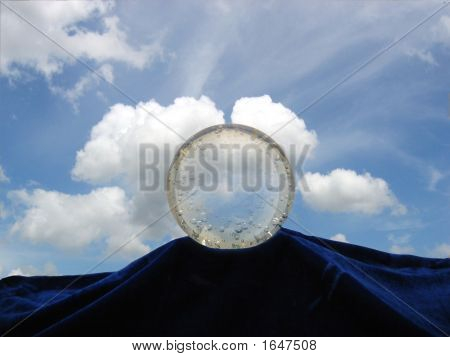 Crystal Ball Against A Bright Blue Sky
