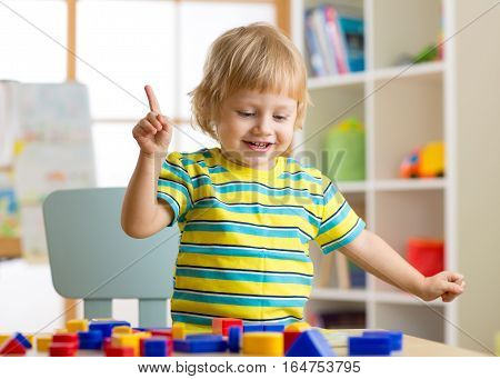 Child boy learning shapes early education and daycare concept