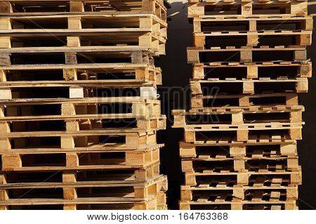 wooden pallet overlap in warehouse . Transport platform