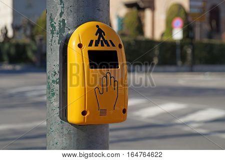 Close up of yellow crosswalk button for pedestrian