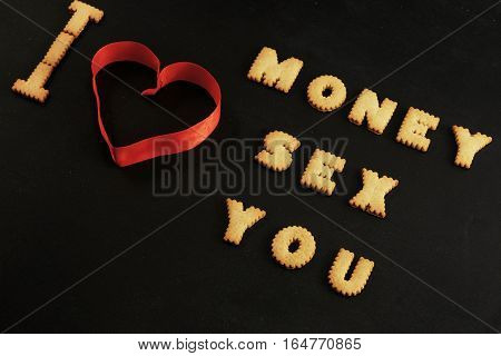 Words money sex you made with letters on black