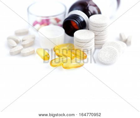 Medical Capsules And Vitamins Isolated On A White Background