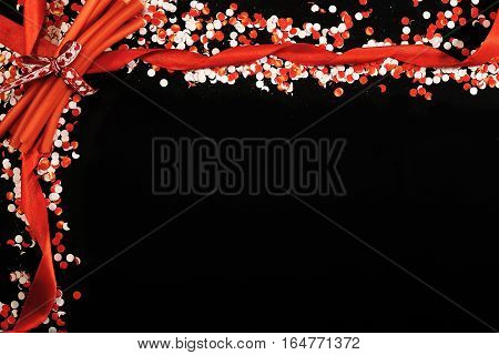 White and red confetti on blackboard copy space