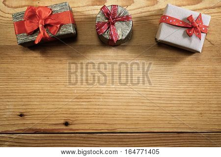 Three gift boxes with copy space on wood
