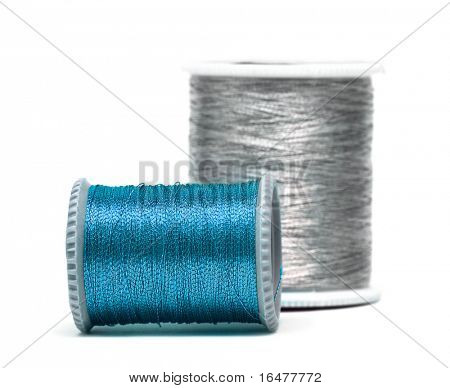 blue and silver spools of threads