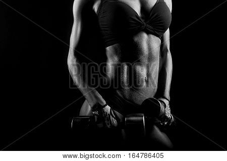 Goal worth sweating. Cropped closeup of a stunning muscular female torso of a fitness woman body wet after a hard workout