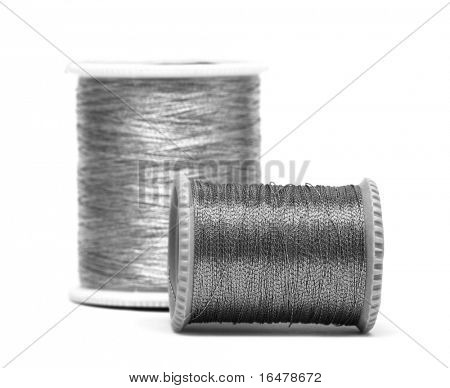 grey and silver spools of threads