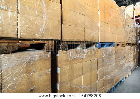 Warehouse transport and logistics company. A stack of cardboard boxes. Cardboard boxes wrapped in stretch film.